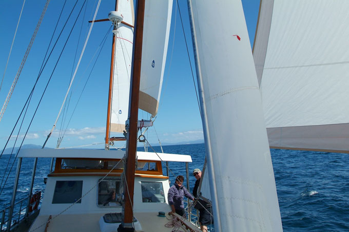 Westernport ketch Amazing Grace 4 sail reaching down the east coast of Tasmania, with her new set of roller furling Ryan Cruising sails.